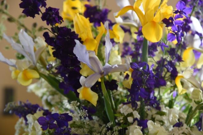 The vase includes Dutch Iris, Larkspur, Sweet William, Antirrhinum and Ami majus