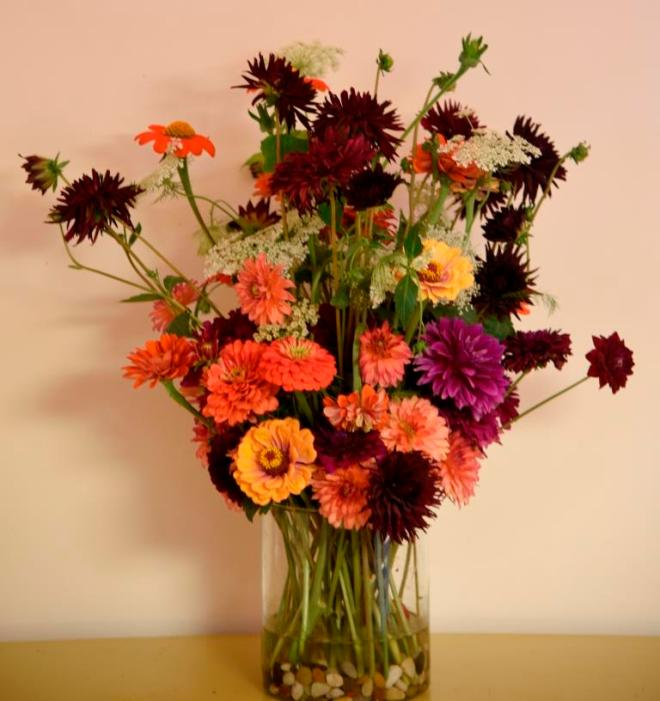 Rich purples and tones of orange give a sumptuous rich velvet coloured vase