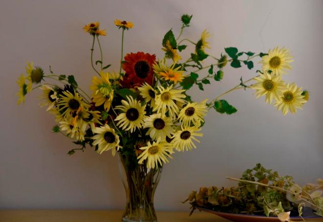 A vase of mixed sunflowers and some Rudbeckia